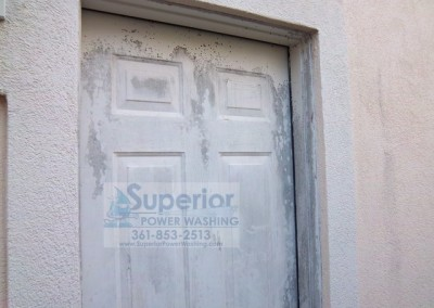 Cleaning Mold Mildew on door of Stucco House 3 before